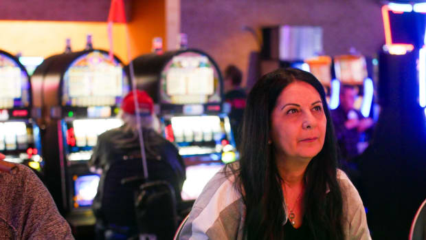 Virginia Watts, 52, playing a machine version of poker with her husband, Sam. The couple comes to the Mohawk casino at least twice a month to get away from their kids, work, and in-laws.