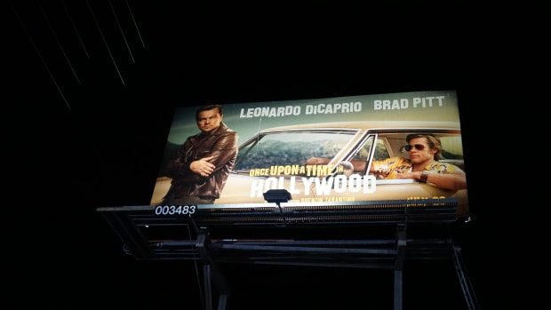 """billboard for Quentin Tarantino's ninth film 'Once Upon a Time…In Hollywood', Leonardo DiCaprio, Brad Pitt, """"the only good Indian is a dead Indian"""""""