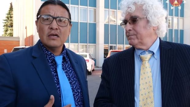 Chase Iron Eyes and his lawyer Dan Sheehan outside the courthouse in Devil's Lake, North Dakota just after the hearing in which Judge Lee Christofferson agreed to unseal depositions by law enforcement officers in Iron Eyes' criminal case.