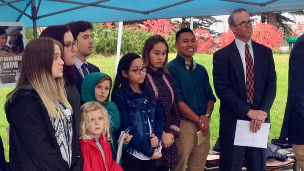 Several of the plaintiffs and their attorneys spoke at a press conference held outside the courthouse after oral arguments. Back row (left to right): Kaytlyn Kelly, 19, Palmer; Sebastian Kurland, 20, Juneau; Andrew Welle, attorney; Front row (left to right): Lila S, 7, Homer; Cecily S, 9, Homer; Lexine D., Gwitch'in, 10, Fairbanks; Summer Sagoonik, Inupiaq, 18, Unalakleet; Esau Sinnok, Inupiaq, 21, Shishmaref; Brad De Noble, attorney.