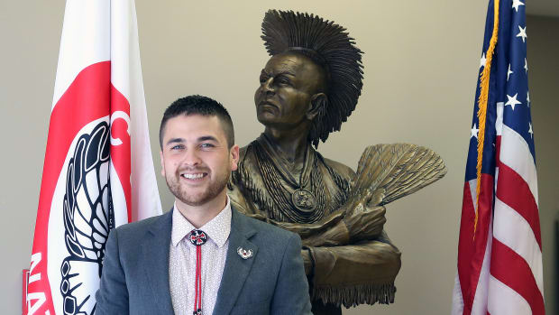 Pictured: Justin Freeland Wood, Principal Chief of the Sac & Fox Nation with Black Hawk Bronze.