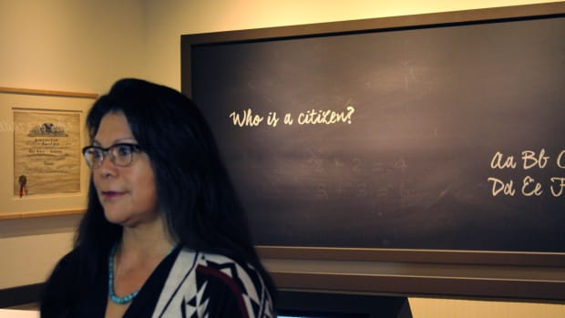 """Patty Talahongva, an award-winning freelance journalist who attended Phoenix Indian School in the 1978-79 school year, served as an advisory committee member to the new """"Away From Home"""" exhibit at the Heard Museum. (Photo by Julian Hernandez/Cronkite News)"""