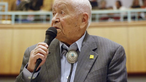 """Democratic New Mexico state Sen. John Pinto talks about his career as a lawmaker on American Indian Day in the Legislature on Friday, Feb. 2, 2018, in Santa Fe, N.M. Pinto joined the Senate in 1977 and is 92 years old. He was a Marine who trained as a Navajo code talker during World War II. His singing of the """"Potato Song"""" is an annual Senate ritual. (AP Photo/Morgan Lee)"""