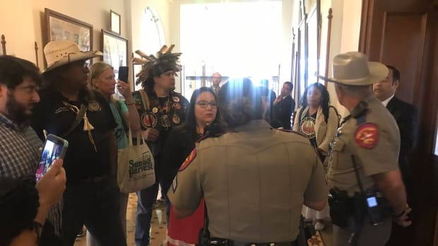 Texas State Capitol police detain members of the Society of Native Nations.
