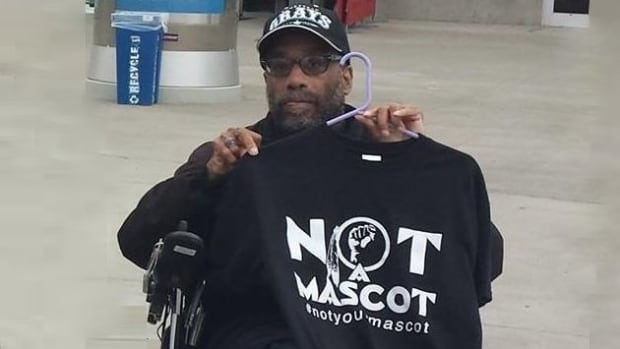 Gary Norris Gray at an Oakland protest for 'Not Your Mascot'