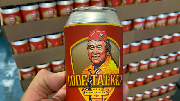 LT Goodluck holds the Code Talker beer can featuring an illustration of his grandfather, Navajo Code Talker John V. Goodluck (Photo courtesy of LT Goodluck)