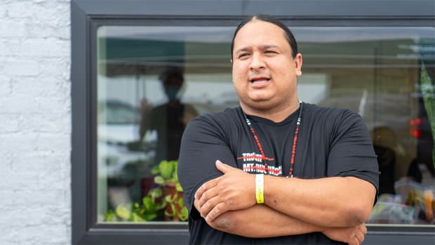 NDN Collective President and CEO Nick Tilsen stands outside of the NDN Headquarters upon his release from Pennington County jail in Rapid City, South Dakota on July 6. (Photo by Arlo Iron Cloud via NDN Collective)