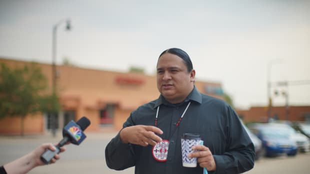 Pictured: NDN Collective President and CEO Nick Tilsen talks to media outside of the NDN Collective headquarters in the hour leading up to his preliminary hearing on Friday morning.