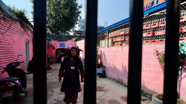 Indira Ranamagar of the Magar tribe in Nepal is the executive director of Prisoner's Assistance Nepal. She is shown here inside the main prison in Kathmandu. (Photo by Mary Annette Pember)