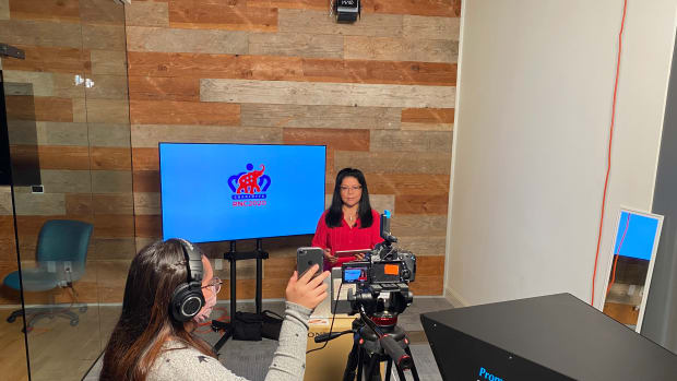 Executive producer Patty Talahongva, Hopi, and intern Quindrea Yazzie, Diné, recording the weekday newscast at the Phoenix Indian School Visitor Center in Phoenix, Arizona. (Photo by Indian Country Today)
