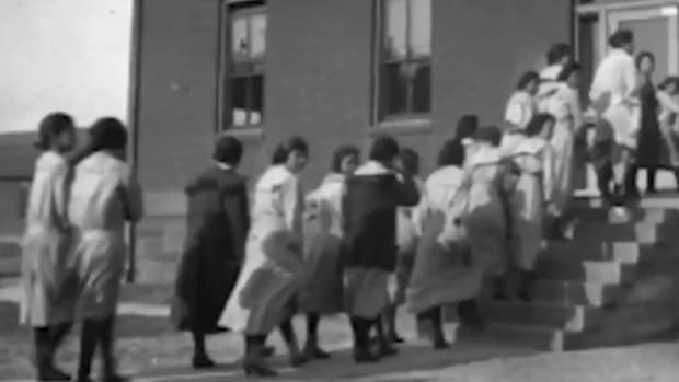 """Students line up to enter a building on the campus of the Rapid City Indian Boarding School in this undated photo. The school operated from 1898 until 1933. Disputes over the school's land after it closed have """"proven to be an ongoing, nagging issue that … is not going away,"""" said Rapid City Mayor Steve Allender. (Photo courtesy of the South Dakota State Historical Society)"""