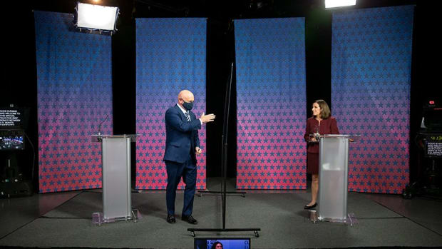 Democrat Mark Kelly arrives to debate U.S. Sen. Martha McSally, R-Arizona, on Tuesday. The two were separated by plexiglass. In-person early voting begins Wednesday. (Photo by Rob Schumacher/POOL/The Arizona Republic via USA TODAY NETWORK)
