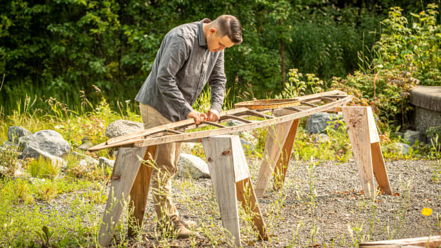 At the Alaska Native Heritage Center in Anchorage, Dustin Newman (Unangax/Deg Hit'an) builds an Aleutian style kayak known as igyax. (Photo Credit: Mike Conti, courtesy of Alaska Native Heritage Center)