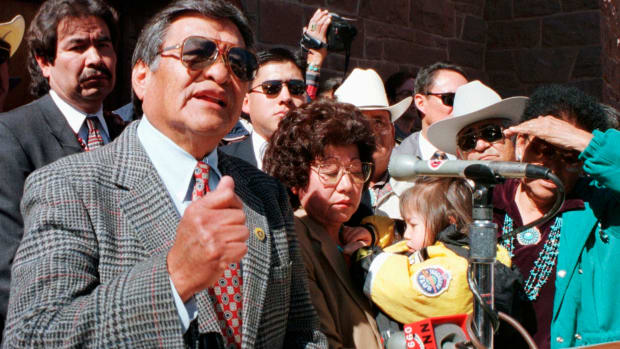 In this Feb. 19, 1998, file photo, then newly sworn-in Navajo Nation President Thomas Atcitty, second from left at podium, speaks to the Navajo Nation for the first time as their new leader, as former President Albert Hale, left, looks on in front of the Navajo Nation Council Chambers in Window Rock, Ariz. Atcitty, a former interim Navajo Nation president and longtime New Mexico state representative has died. The tribe says Thomas Atcitty died Sunday, Oct. 11, 2020, of natural causes. He was 86. Funeral services are scheduled Wednesday ,Oct. 14, in Shiprock, New Mexico, where Atcitty lived most of his life. (Donovan Quintero/Gallup Independent via AP, File)