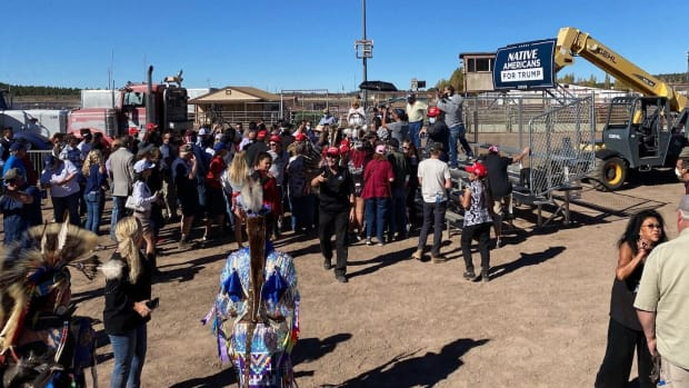 "People gather on risers at the Williams, Arizona, rodeo grounds under a ""Native Americans for Trump"" banner Thursday, Oct. 15, 2020. (Photo by Carina Dominguez, Indian Country Today)"