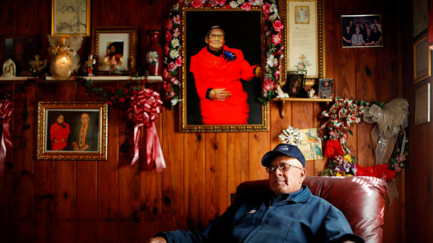 In this 2017 photo, Horace Locklear of Fairmont, N.C. a member of the Lumbee Tribe sits in his living room.  While he voted for President Obama in 2009, he voted for President Trump in 2016  because he thinks he can bring jobs to the region – and also, based on his reading of the Bible, because he doesn't think a woman should be president. (AP Photo/David Goldman)
