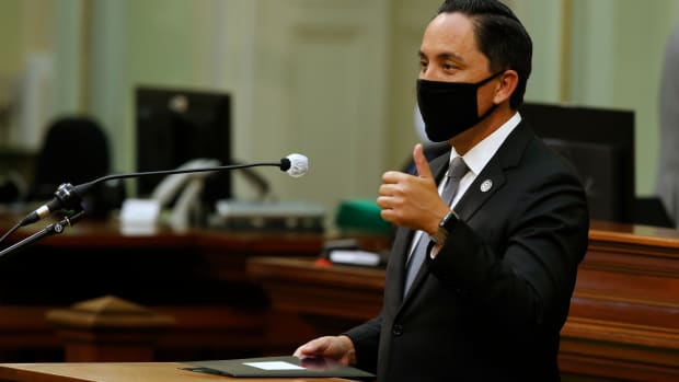 In this Monday, June 8, 2020, file photo, Assemblyman Todd Gloria, D-San Diego, gives a thumbs-up as he asks lawmakers to approve his measure to increase mental health funding for the homeless, at the Capitol in Sacramento, Calif. Gloria, a gay state legislator, is a leading contender in the race to become mayor. (AP Photo/Rich Pedroncelli, File)