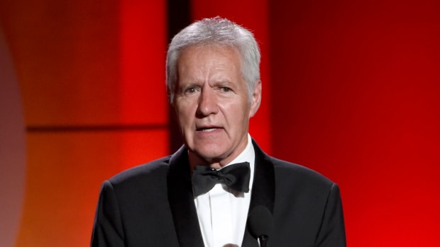 """In this April 30, 2017, file photo, """"Jeopardy!"""" host Alex Trebek speaks at the 44th annual Daytime Emmy Awards in Pasadena, Calif. Jeopardy!"""" host Alex Trebek died Sunday, Nov. 8, 2020, after battling pancreatic cancer for nearly two years. Trebek died at home with family and friends surrounding him, """"Jeopardy!"""" studio Sony said in a statement. Trebek presided over the beloved quiz show for more than 30 years. (Photo by Chris Pizzello/Invision/AP, File)"""