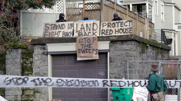 "This Dec. 8, 2020 photo shows a home on North Mississippi Avenue in Portland, Ore. where protesters have camped to prevent a Black and Indigenous family from being forced to leave the foreclosed home, which has been dubbed the ""Red House on Mississippi"". (Beth Nakamura/The Oregonian via AP)"