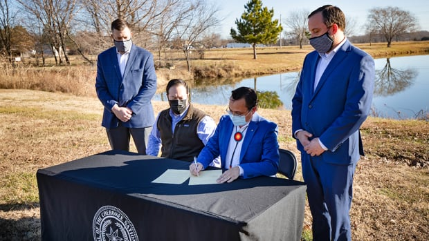 Pictured L to R: Cherokee Nation Chief of Staff Todd Enlow, Deputy Chief Bryan Warner, Principal Chief Chuck Hoskin Jr., Secretary of Natural Resources Chad Harsha. Chief Hoskin signed the Cherokee Nation Hunting and Fishing Compact extension with the State of Oklahoma on Thursday in Tahlequah.