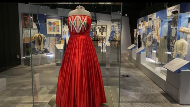 """Isabella Aiukli Cornell's 2018 prom dress is on display in """"Girlhood,"""" a new exhibit at the Smithsonian National Museum of American History. Designer Della Bighair-Stump chose red to bring attention to the peril faced by Indigenous women. (Photo by Emma Sears/Gaylord News)"""