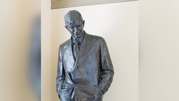 A statue of Will Rogers smiles down from his pedestal in the House connecting corridor on the second floor of the Capitol. (Photo courtesy of Architect of the Capitol/aoc.gov)