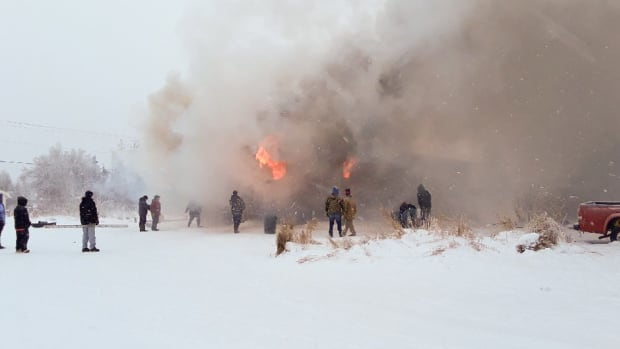 On Jan. 16, a fire broke out in Tuluksak, a western Alaskan village. Locals tried to extinguish the fire, which destroyed the community's only water plant. (Photo by Kristy Napoka, Alaska Public Media)