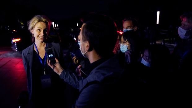 Thea Koelsen Fischer of the World Health Organization team speaks to journalists outside after a WHO-China Joint Study Press Conference held at the end of the WHO mission in Wuhan, China, Tuesday, Feb. 9, 2021. (AP Photo/Ng Han Guan)