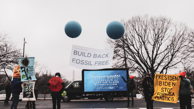 """Pictured: """"Build Back Fossil Free"""" rallies were held nationwide, including outside the White House."""
