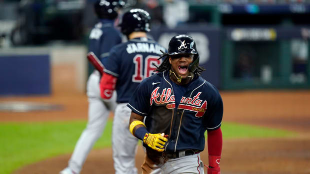 Atlanta Braves' Ronald Acuna Jr. (13) celebrates after scoring during the third inning in Game 3 of a baseball National League Division Series against the Miami Marlins, Thursday, Oct. 8, 2020, in Houston. (AP Photo/Eric Gay)