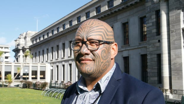 """Maori Party co-leader Rawiri Waititi poses for a photo outside New Zealand's Parliament in Wellington in October 2020. Waititi this week won a battle against wearing a tie in the Parliament, ending a longstanding dress requirement that he describes as a """"colonial noose."""" (AP Photo/Nick Perry)"""