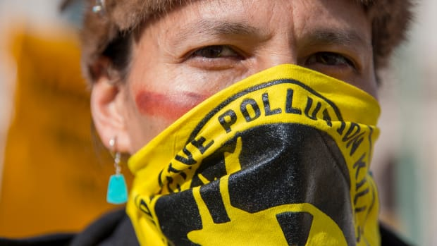 Klee Benally of the Navajo Nation at a 2016 protest outside the Environmental Protection Agency in Washington, demanding cleanup of abandoned uranium mines. Even though mining stopped decades ago – and was banned by the tribe in 2005 – the fight to clean up the toxic sites has lingered. (File photo by Danika Worthington/Cronkite News)