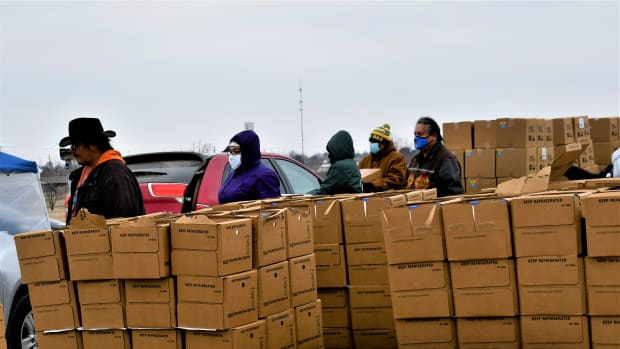 Kiowa volunteers work to provide nearly 45,000 pounds of boxed-up food to tribal members and non-Native members of the community. (Photo by the Kiowa Tribe via Gaylord News)