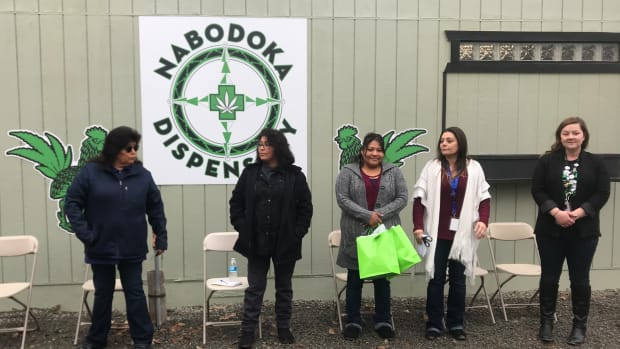 Tribal officials and citizens of the Lovelock Paiute Tribe in Nevada gather during the grand opening of a marijuana dispensary opened in February 2021. (Photo courtesy Tribal Cannabis Consultants via South Dakota News Watch)