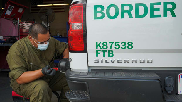 U.S. Army Sgt. Juan Arriaga repairs a light on a Border Patrol truck in Brownsville, Texas, in August. Thousands of National Guard troops and active-duty soldiers were deployed to the border, but they could only act in support roles – delivering meals, driving and repairing vehicles and assisting with border surveillance, among other jobs. (Photo by Staff Sgt. De'Jon Williams/National Guard)