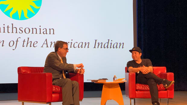Tommy Orange speaking with a book reviewer from the Washington Post at the National Museum of American Indians in Washington, D.C., on May 8, 2019. (Photo by Jourdan Bennett-Begaye, Indian Country Today, File)