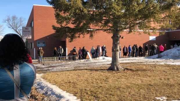People line up to receive COVID-19 vaccines on the Leech Lake reservation during the tribe's weekly clinic on Friday March 5. The clinic serves Native and non-Natives. (Photo by Mary Annette Pember)