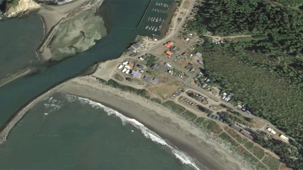 The Quileute village of La Push, shown here in 2021, is bordered on the north by the Quillayute River and on the west by the Pacific Ocean in northwestern Washington State. The Quileute Tribe is working to relocate the village because of increasing threats of flooding caused by climate change. (Photo by USGS, Google Earth)