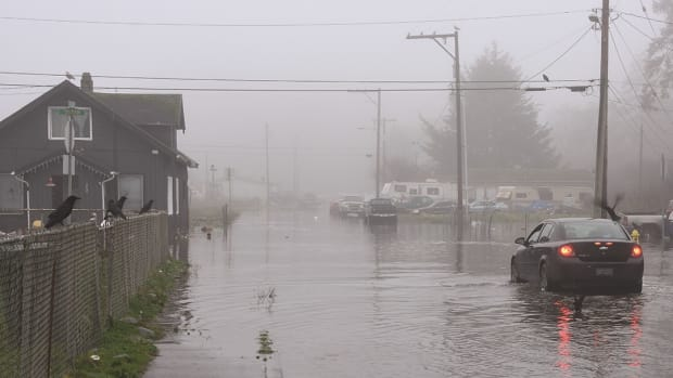 The Quinault Nation community of Taholah was flooded in January 2021 when the ocean breached a seawall. The tribe is in the process of relocating to higher ground because of problems caused by climate change. (Photo by Larry Workman, Quinault Nation)