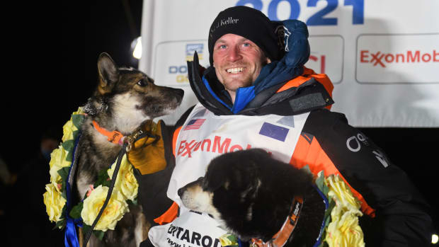 Dallas Seavey poses with his dogs after winning the Iditarod Trail Sled Dog Race race near Willow, Alaska, early Monday, March 15, 2021. (Marc Lester/Anchorage Daily News via AP, Pool)