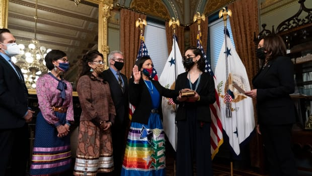 Vice President Kamala Harris, right, speaks during a ceremonial swearing in for Interior Secretary Deb Haaland, third from right, with daughter Somáh Haaland, second from right, in the Vice President's ceremonial office in the Eisenhower Executive Office Building on the White House campus, Thursday, March 18, 2021, in Washington. (AP Photo/Alex Brandon)