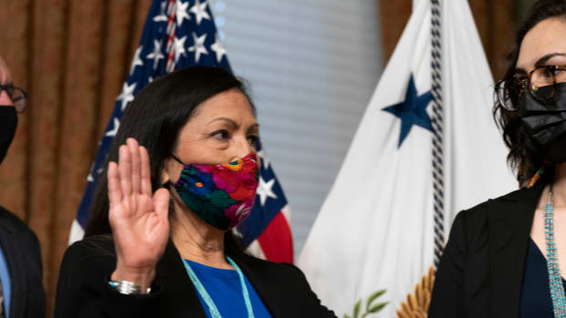 Interior Secretary Deb Haaland holds her hand up during a ceremonial swearing with Vice President Kamala Harris, in the Vice President's ceremonial office in the Eisenhower Executive Office Building on the White House campus, Thursday, March 18, 2021, in Washington. (AP Photo/Alex Brandon)