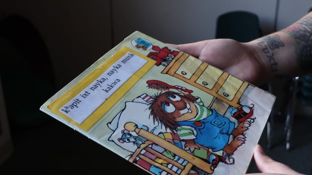 "A book from the Grand Ronde language program classroom, ""All By Myself"" translated to Chinuk Wawa for early-language learners. (Photo by Kamiah Koch)"