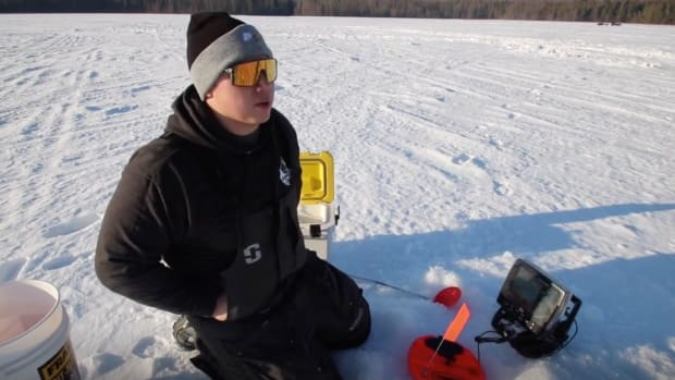 Ryon Alloway, Forest County Potawatomi, ice fishing in Wisconsin. (Photo by Kaitlin Boysel, Indian Country Today)
