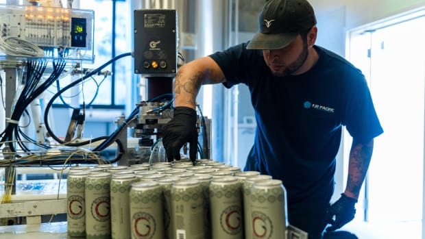 A worker at the 3R Brewery cans the Luiseño Hazy IPA. The brewery reopened in late 2020 after a Covid shutdown with its new name and new offerings. (Photo courtesy of Rincon Reservation Road Brewery).