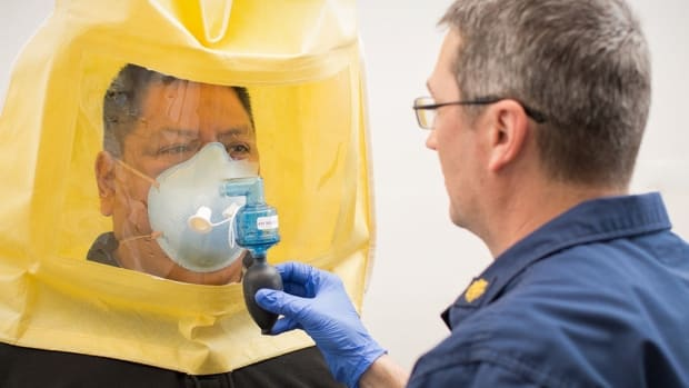 """IHS Emergency Management Coordinator Gerald Johnson, Navajo, is being """"fit tested"""" for an N95 respirator. These masks are required for healthcare workers working with critical respiratory diseases. (Photo by Reba Benally 
