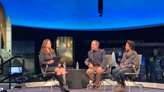 """John Herrington, Chickasaw and the first Native American to travel in space, and pilot Ariel Tweto, Inupiaq, speak with Mandy Van Heuvelen, Mnicoujou Lakota, who is the cultural interpreter program coordinator at the National Museum of the American Indian, about """"Into America's Wild"""" on stage at the Smithsonian National Air and Space Museum in Washington, D.C. (Photo by Jourdan Bennett-Begaye)"""