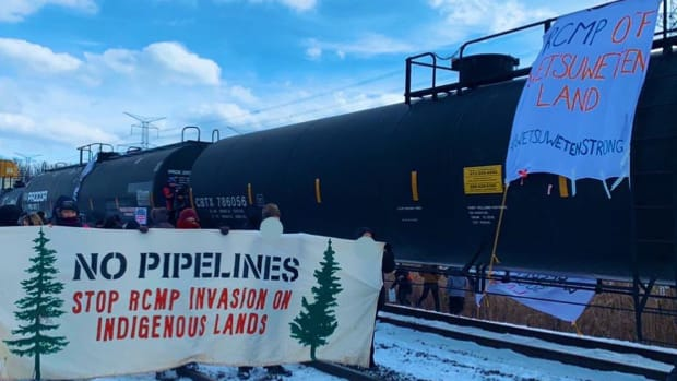 """""""A total of nearly 400 people have now blocked BOTH the 1st and 2nd largest rail yards in Canada, blocking US-bound CN trains. We will #shutdowncanada until the Wet'suwet'en demands for RCMP withdrawal and #noaccesswithoutconsent are respected. #WetsuwenStrong"""""""