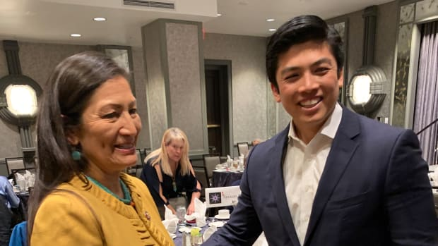 """PaaWee Rivera, Pojoaque Pueblo, greets Rep. Deb Haaland at the 24th Annual National Indian Women's """"Supporting Each Other"""" Honoring Lunch in February 2019 in Washington, DC. Sen. Elizabeth Warren received an """"Appreciation Award"""" from the organization. (Photo by Jourdan Bennett-Begaye)"""