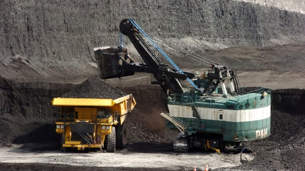 FILE - In this April 4, 2013, file photo, a mechanized shovel loads a haul truck that can carry up to 250 tons of coal at the Spring Creek coal mine near Decker, Mont. (AP Photo/Matthew Brown, File)